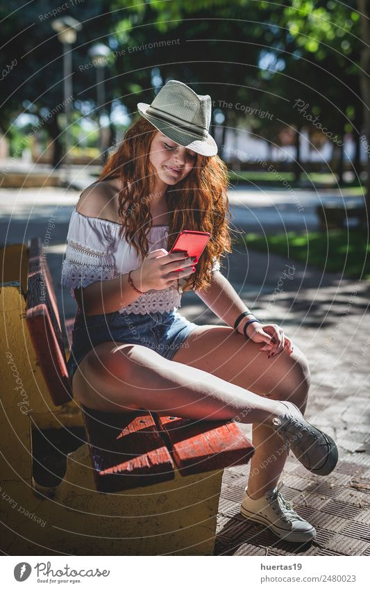 Outdoor portrait of young beautiful happy redhead girl Lifestyle Elegant Style Happy Beautiful Cellphone Human being Feminine Young woman Youth (Young adults)