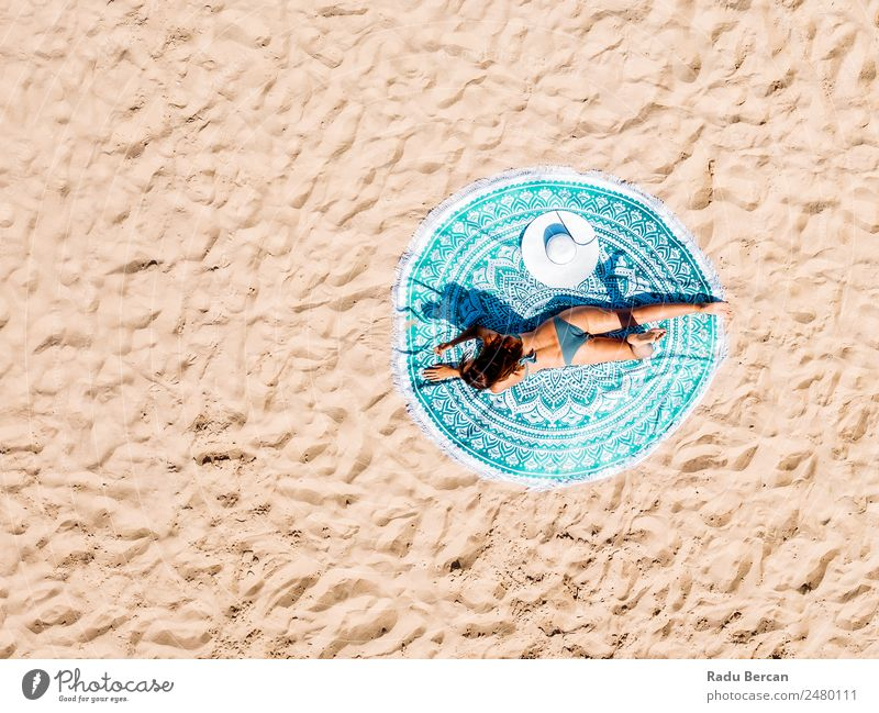 Top Aerial Drone View Of Woman In Swimsuit Bikini Relaxing And Sunbathing On Round Turquoise Beach Towel Near The Ocean Vantage point Aircraft Summer