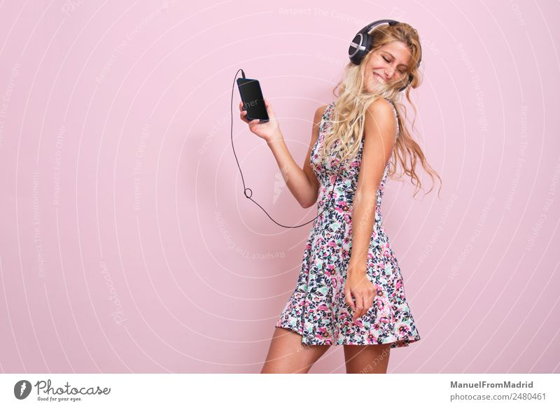 Young woman listening to music Lifestyle Happy Beautiful Music Dance Telephone Youth (Young adults) Woman Adults Body 18 - 30 years Blonde Listening Smiling