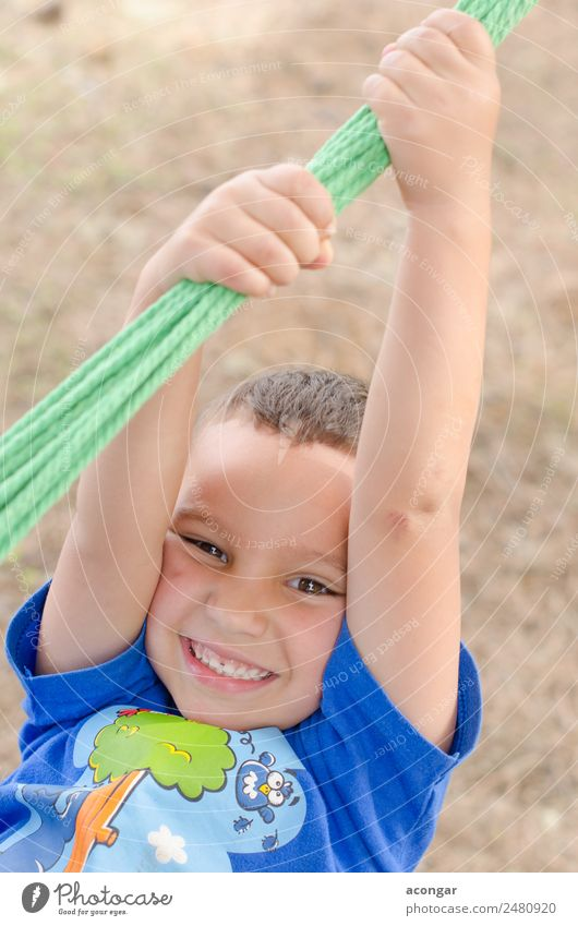 Boy having fun, holding on to a rope. Child Human being Beautiful Joy Face Funny Happy Boy (child) Infancy Happiness To enjoy Curiosity Rope Climbing Euphoria