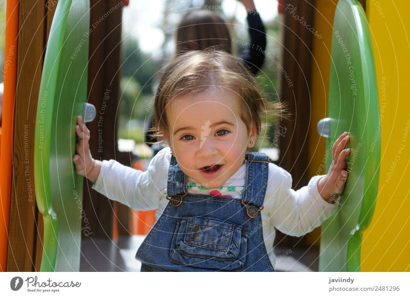 Happy little girl playing in a urban playground. Lifestyle Joy Beautiful Leisure and hobbies Playing Summer Climbing Mountaineering Child Human being Baby Girl