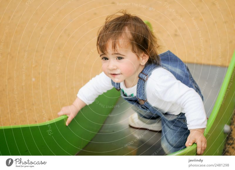 Happy little girl playing in a urban playground Child Human being Summer Beautiful Joy Girl Lifestyle Emotions Laughter Small Playing Leisure and hobbies Park