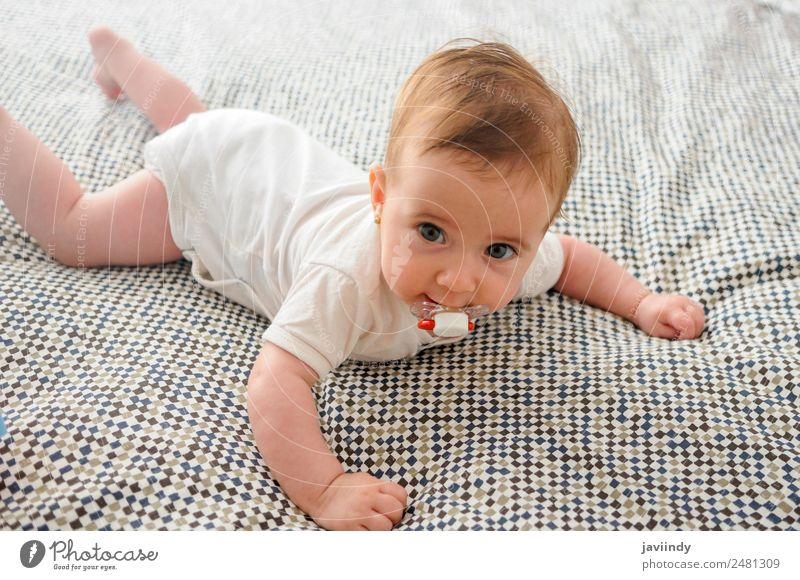 Happy baby girl, four months old, on the bed with pacifier. Beautiful Face Life Child Human being Baby Girl Infancy 1 0 - 12 months Smiling Sleep Small New Cute