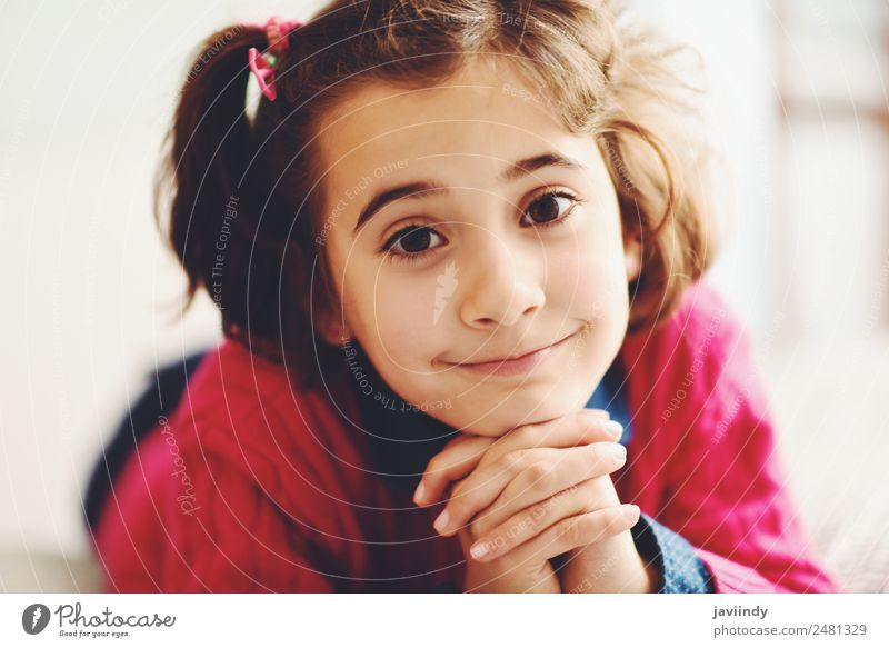 Adorable little girl with sweet smile lying down on bed. Joy Happy Beautiful Face Child Human being Girl Infancy 1 3 - 8 years Smiling Small Cute White cheerful