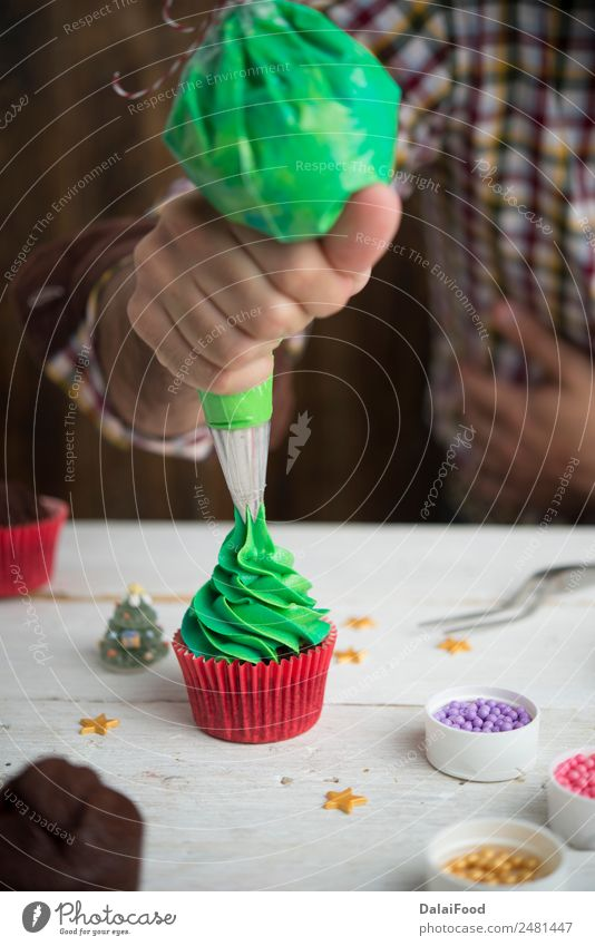 Making cupcake for christmas time Dessert Winter Decoration Feasts & Celebrations Christmas & Advent Tree Wood Delicious New Green Red White background Baking