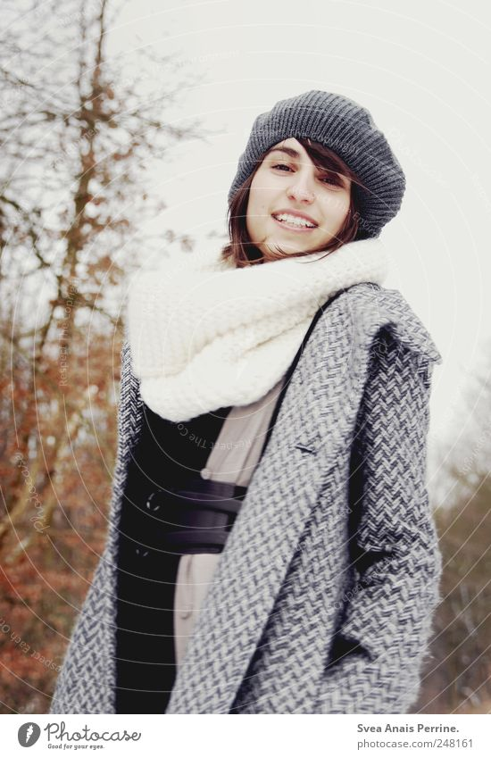 smile. Feminine Young woman Youth (Young adults) Face 1 Human being 18 - 30 years Adults Autumn Winter Tree Fashion Coat Scarf Cap Brunette Smiling Uniqueness