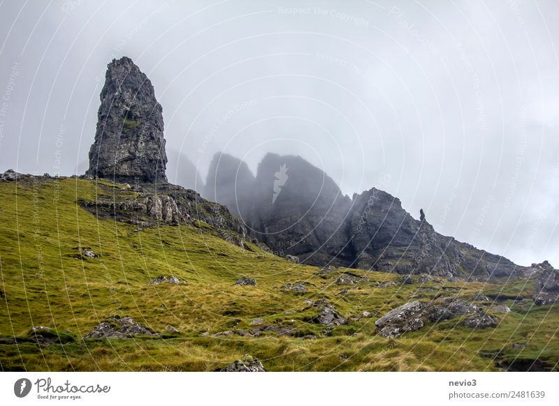 Old Man of Storr on the Isle of Skye in Scotland Landscape Autumn Climate Weather Bad weather Fog Grass Meadow Hill Rock Mountain Peak Green Wall of rock