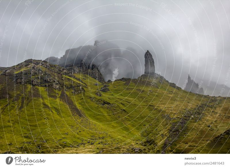 Old Man of Storr on the Isle of Skye in Scotland Landscape Clouds Summer Autumn Bad weather Fog Grass Green Travel photography Island Mountain Mountaineering