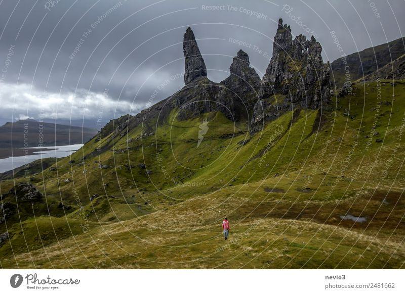 Old Man of Storr on the Isle of Skye in Scotland Landscape Clouds Storm clouds Climate Bad weather Wind Grass Hill Rock Mountain Peak Exceptional Dirty