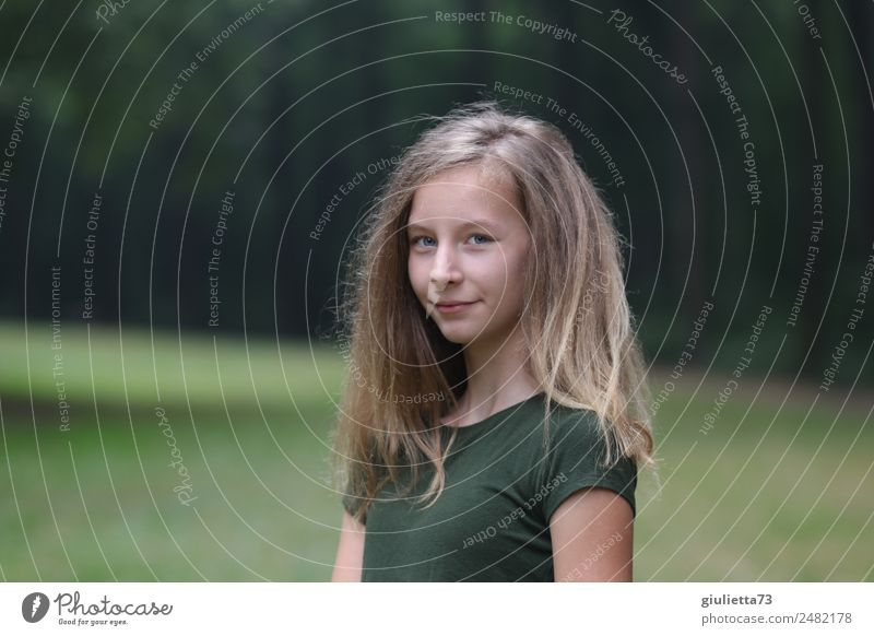 Thirteen and a half teenage girls in the park. Girl Youth (Young adults) 1 Human being 8 - 13 years Child Infancy 13 - 18 years Park Blonde Long-haired Smiling