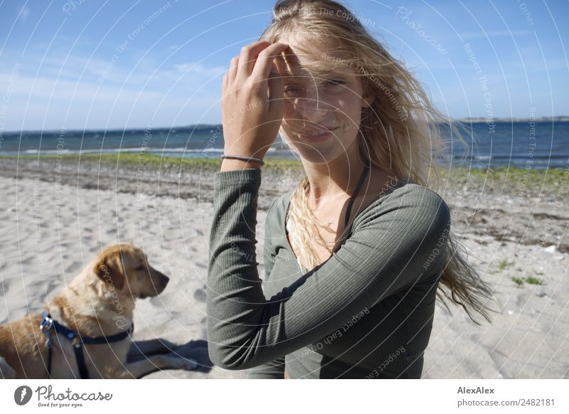 Young woman with blond Labrador at the Baltic Sea beach Lifestyle Beautiful Harmonious Summer Summer vacation Sun Sunbathing Beach Ocean Youth (Young adults)