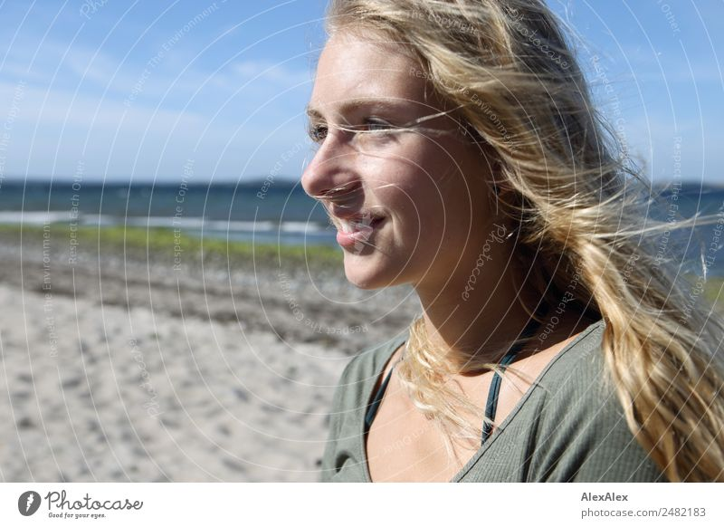 Portrait of a young woman on the beach Joy Beautiful Well-being Summer Summer vacation Sun Young woman Youth (Young adults) Face 18 - 30 years Adults Landscape