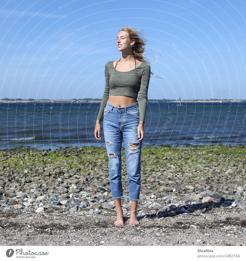 Young woman standing with closed eyes at the Baltic Sea beach Lifestyle Beautiful Body Wellness Harmonious Summer Summer vacation Sun Sunbathing Beach Ocean