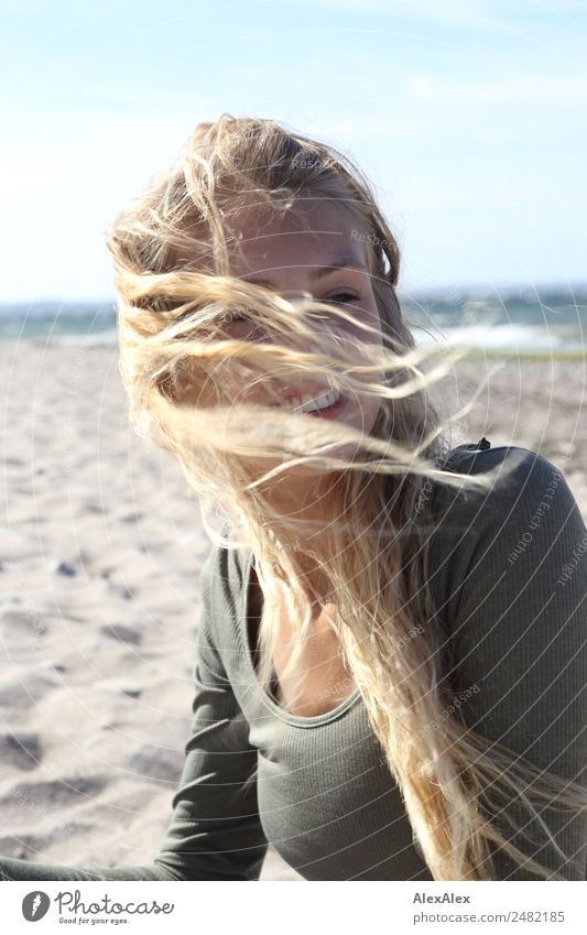 Young woman at the stand blond hair blows around her Beautiful Hair and hairstyles Well-being Trip Youth (Young adults) 18 - 30 years Adults Landscape Summer