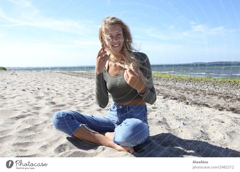 Blonde, young woman at the Baltic Sea beach with blowing hair Lifestyle Joy Happy Beautiful Well-being Summer Summer vacation Sun Sunbathing Beach Ocean