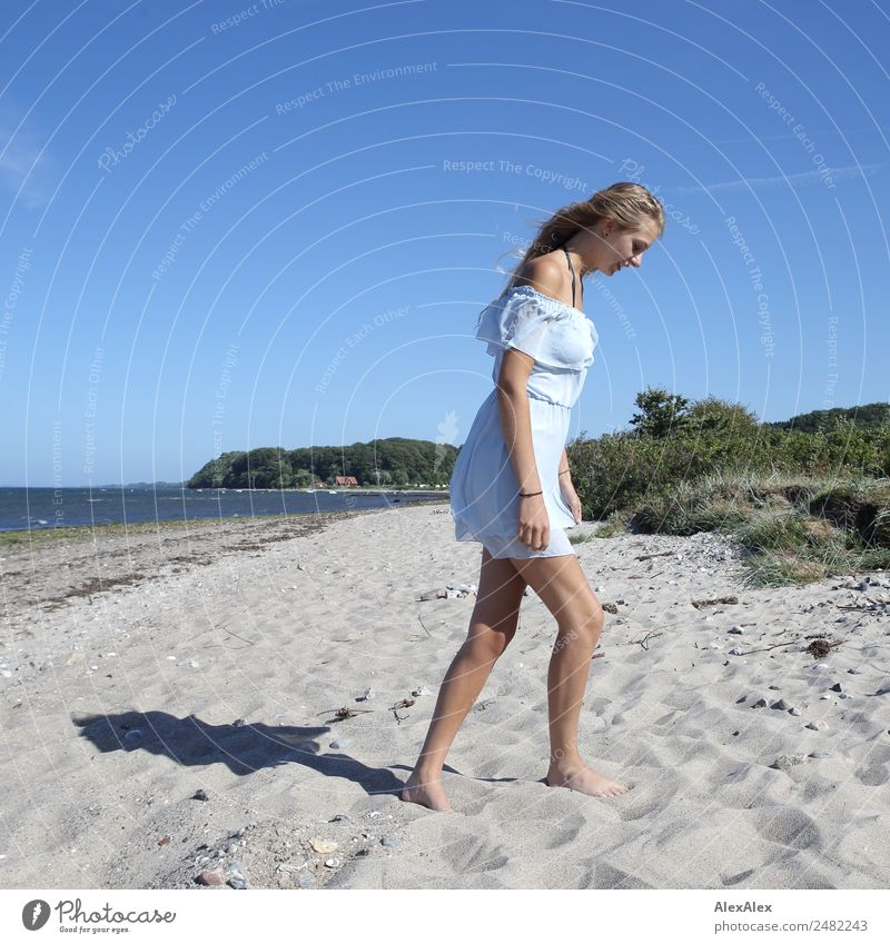 Young woman walks on the beach Style Beautiful Well-being Summer Summer vacation Sun Sunbathing Beach Ocean Youth (Young adults) Legs 18 - 30 years Adults