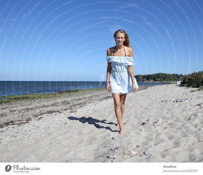 Young woman walks up to someone at the Baltic beach Elegant Beautiful Life Summer Summer vacation Sun Sunbathing Beach Ocean Youth (Young adults) 18 - 30 years