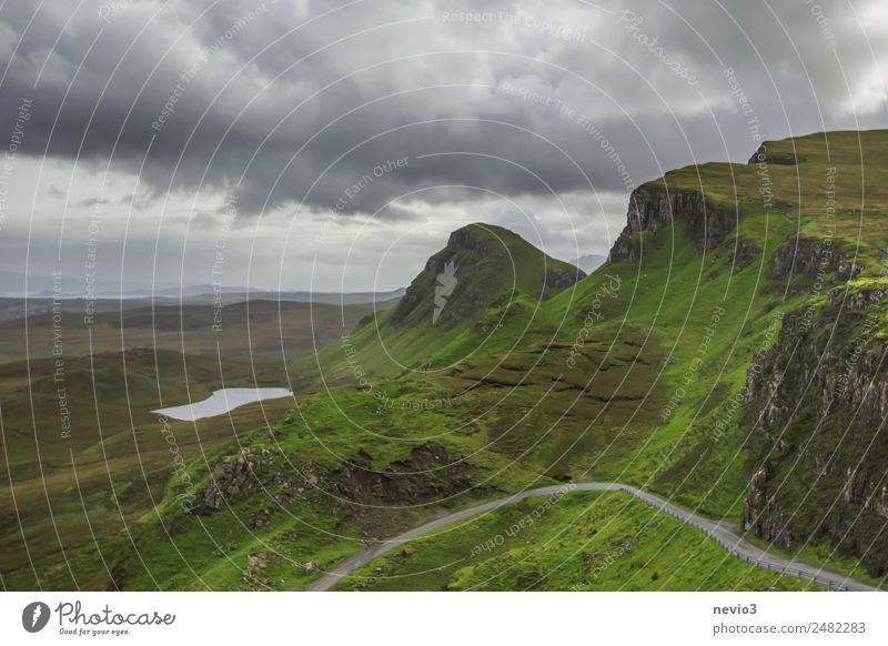 The Quiraing in Scotland Nature Landscape Spring Meadow Hill Mountain Green Isle of Skye Lake Jurassic system Raincloud Steep Country road Street Wiggly line