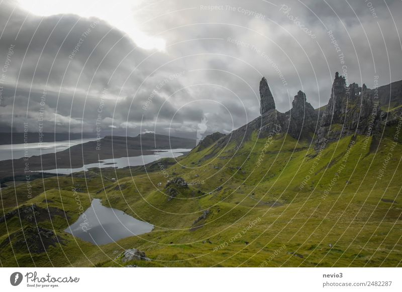 Old Man of Storr on the Isle of Skye in Scotland Landscape Summer Autumn Grass Hill Rock Mountain Green Grassland Island fog Wall of rock Lake Bay Weather Idyll