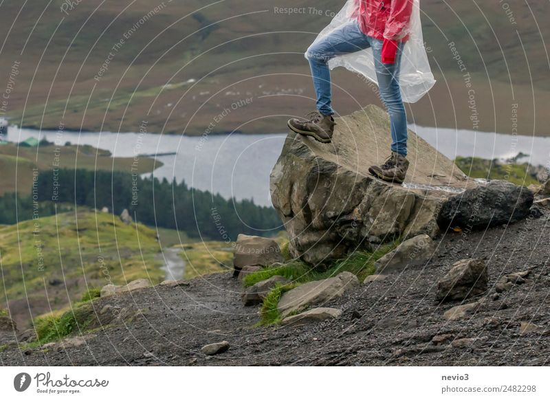 Walker standing on a rock at Old Man of Storr Lifestyle Healthy Vacation & Travel Tourism Trip Adventure Far-off places Sightseeing Mountain Hiking Human being