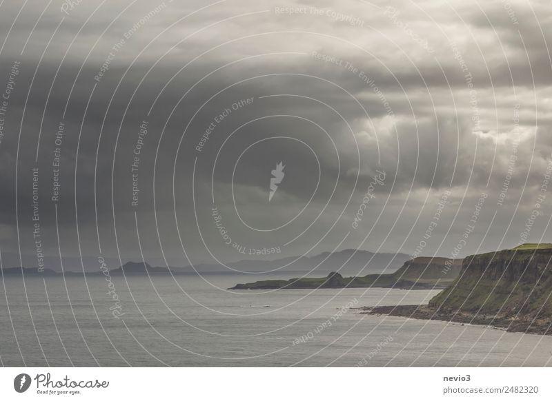 Dark rain clouds on the coast of the Isle of Skye in Scotland Water Storm clouds Bad weather Gale Rain Waves Coast Beach Bay Infinity Wet Black Wanderlust
