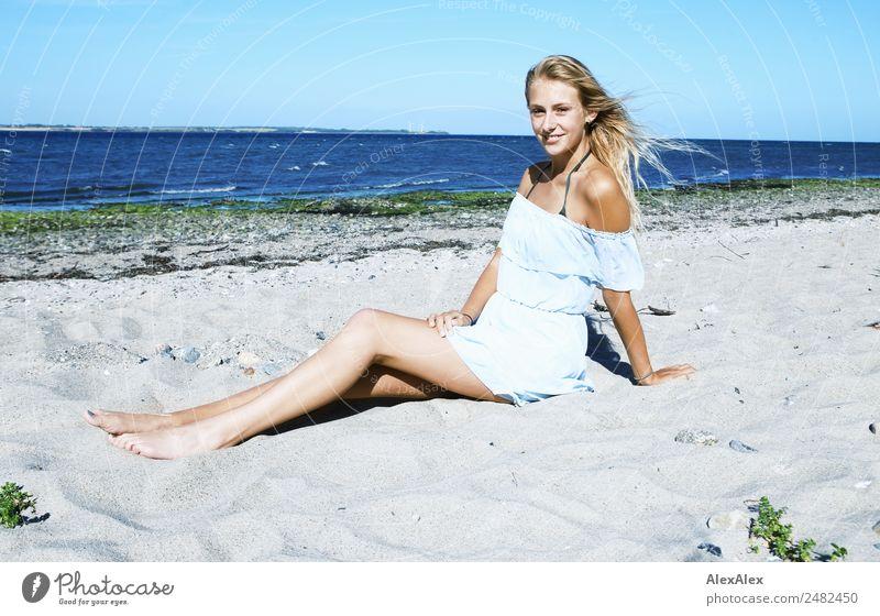 Young, slender, long-legged woman on a Baltic beach in a summer dress Lifestyle pretty Well-being Summer Summer vacation Sun Sunbathing Beach Ocean Young woman