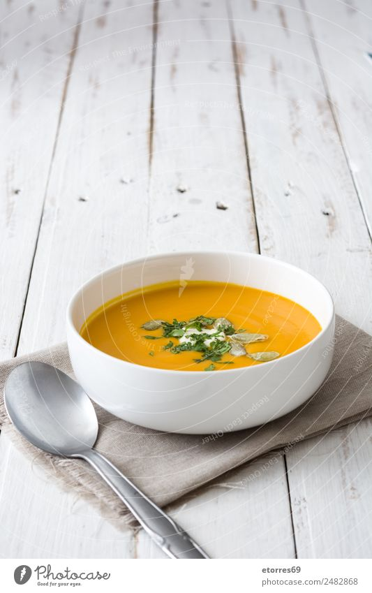 Pumpkin soup in white bowl on white wooden table Food Healthy Eating Food photograph Dish Vegetable Soup Stew Nutrition Organic produce Vegetarian diet