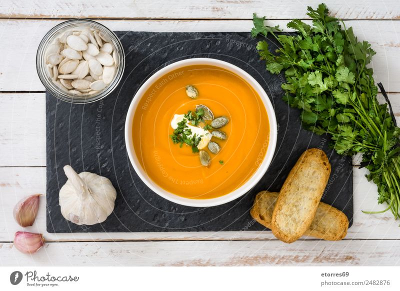 Pumpkin soup Food Vegetable Bread Soup Stew Lunch Bowl Thanksgiving Good Orange Healthy Eating Ingredients Garlic Parsley Seed Wooden table Vegetarian diet