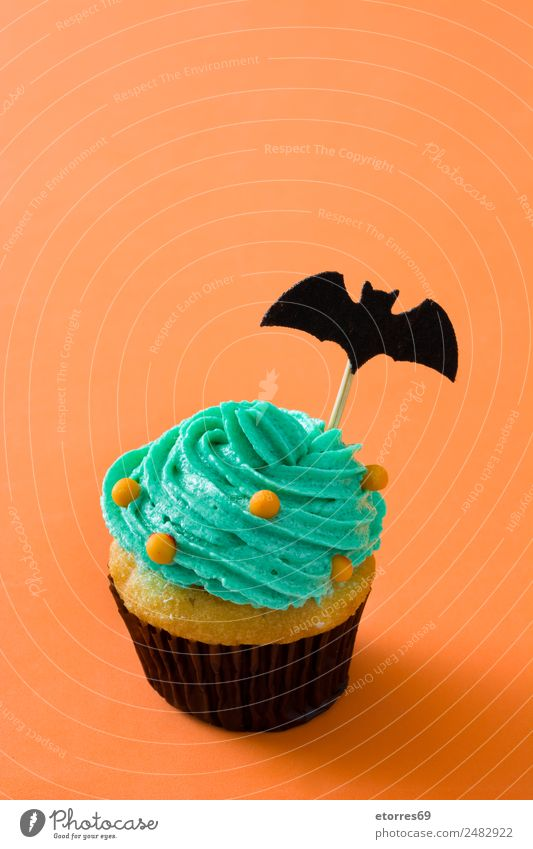 Halloween cupcake Food Cake Dessert Candy Hallowe'en Good Sweet Yellow Green Orange Black Cupcake Funny Bat Fear Butter Baked goods Child Cream Copy Space top