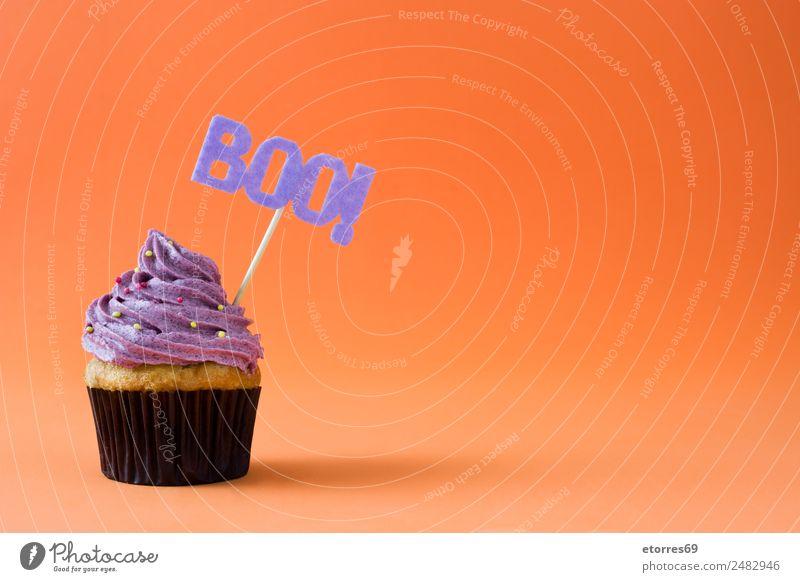Halloween cupcake on orange background Food Cake Dessert Candy Nutrition Hallowe'en Natural Violet Orange Cupcake Food photograph Sweet Cream Decoration Muffin