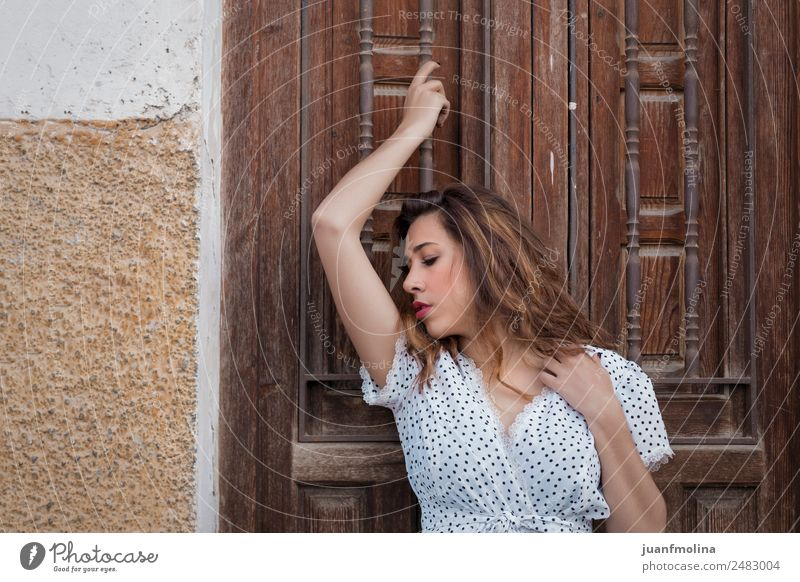 Thoughtful woman next to a door Beautiful Face Human being Woman Adults Hand 18 - 30 years Youth (Young adults) Door Fashion Think Stand Authentic Friendliness