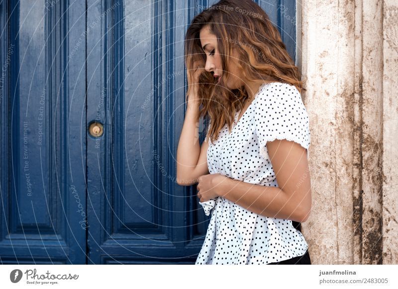 Thoughtful woman next to a door Woman Human being Youth (Young adults) Blue Beautiful White Hand House (Residential Structure) 18 - 30 years Face Adults Natural