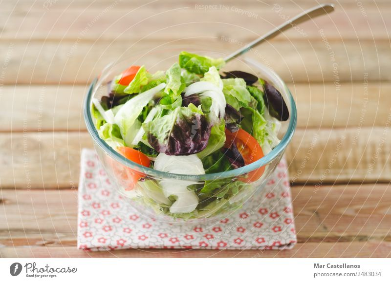Salad bowl on rustic wooden background Vegetable Lettuce Nutrition Eating Breakfast Lunch Dinner Vegetarian diet Diet Plate Bowl Healthy Summer Restaurant