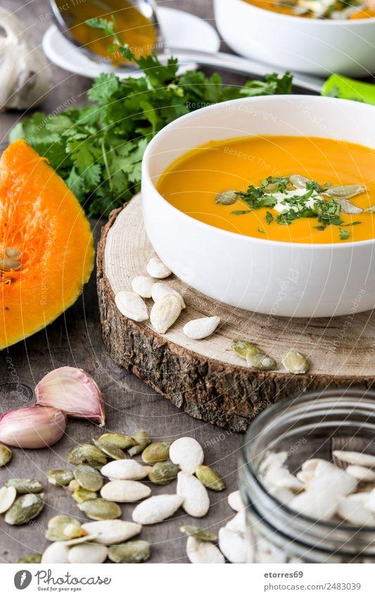Pumpkin soup Healthy Food Orange Nutrition Vegetable Seasons Good Organic produce Seed Bowl Diet Vegetarian diet Wooden table Lunch Vegan diet