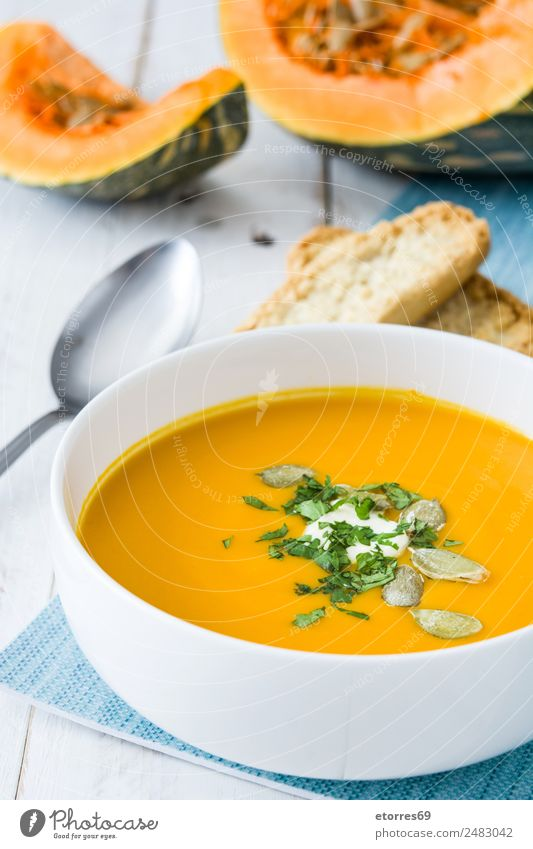 Pumpkin soup Vegetable Bread Soup Stew Nutrition Lunch Dinner Vegetarian diet Diet Bowl Spoon Thanksgiving Good Orange Seed Food Tradition Home-made Tasty