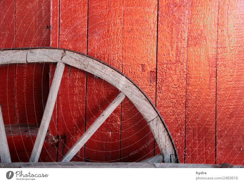 Old wagon wheel in front of red wooden wall in shed Agriculture Forestry Village Fishing village hut Wall (barrier) Wall (building) Chauffeur
