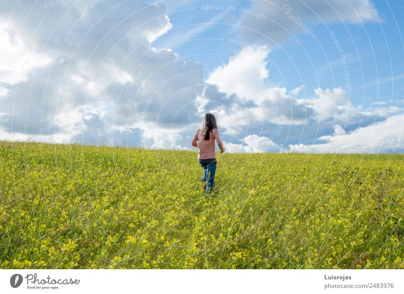girl walking in a field with yellow flowers sunny day Joy Health care Wellness Senses Relaxation Fragrance Vacation & Travel Expedition Feminine Girl