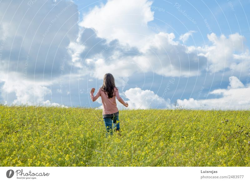 girl walking in a field with yellow flowers sunny day Healthy Relaxation Freedom Summer Feminine Girl 1 Human being 3 - 8 years Child Infancy 8 - 13 years