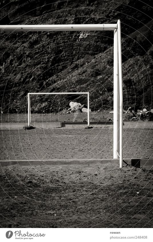 gates Sports Ball sports Soccer Sporting Complex Football pitch Earth Sand Hill Rock Mountain Competition Playing Empty Black & white photo Exterior shot