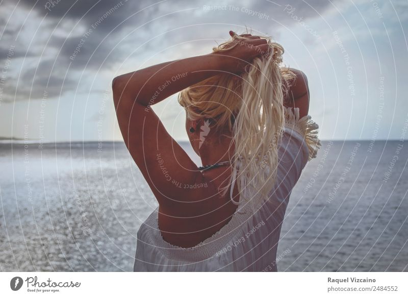woman with the sea in the background. Feminine Young woman Youth (Young adults) Hair and hairstyles 1 Human being 18 - 30 years Adults Sunrise Sunset Summer