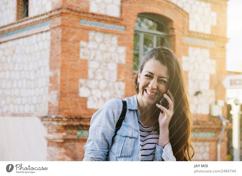beautiful woman talking on the phone while laughing. Lifestyle Style Joy Happy Beautiful To talk PDA Technology Feminine Young woman Youth (Young adults) Woman
