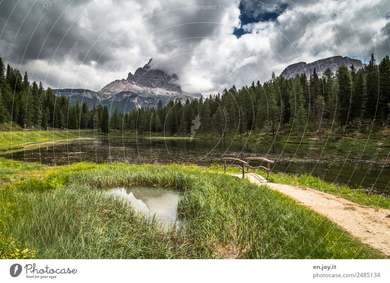 Lago d'Antorno with the Three Peaks Vacation & Travel Trip Adventure Freedom Summer vacation Mountain Hiking Nature Landscape Storm clouds Meadow Forest Rock