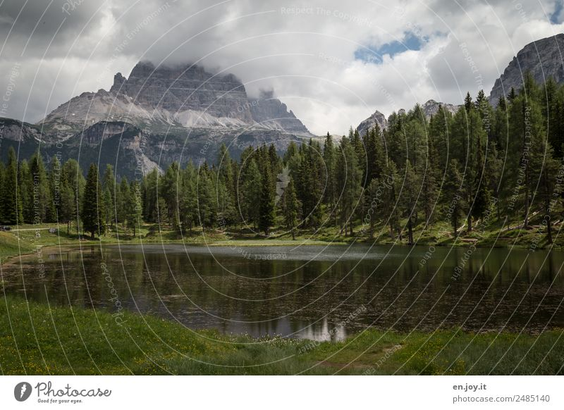 concealment Vacation & Travel Trip Mountain Nature Landscape Plant Clouds Storm clouds Climate Bad weather Forest Rock Alps Dolomites Three peaks Lakeside Italy