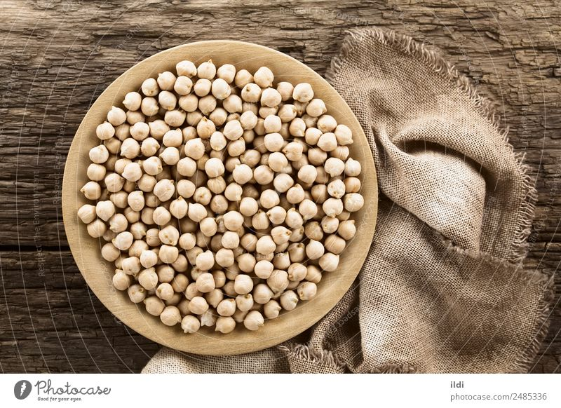 Raw Chickpeas Vegetable Nutrition Healthy Natural food garbanzo Beans Gram Peas legume Pulse dry Dried dehydrated cooking Protein cicer arietinum wooden plate