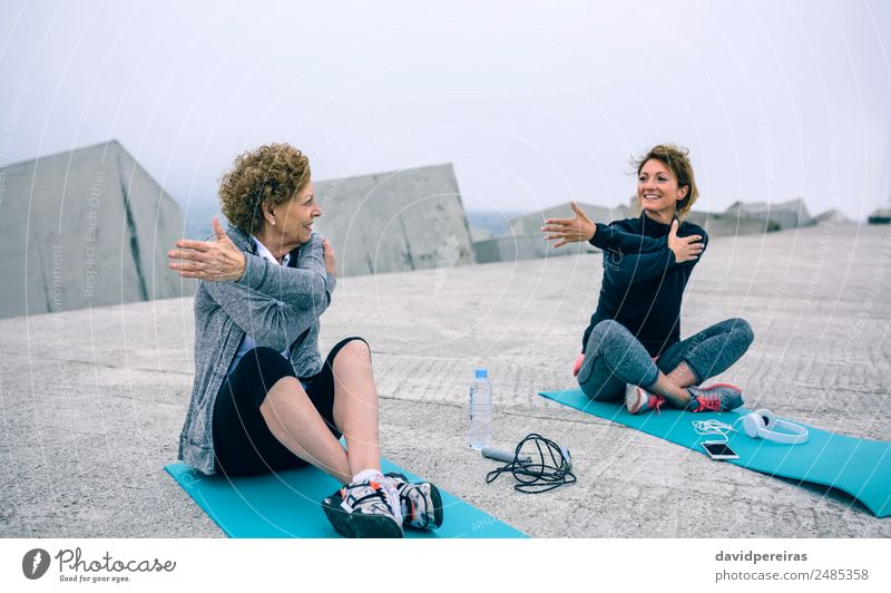 Senior woman stretching with female coach Bottle Lifestyle Wellness Leisure and hobbies Sports School PDA Human being Woman Adults Mother Grandmother Arm Fog