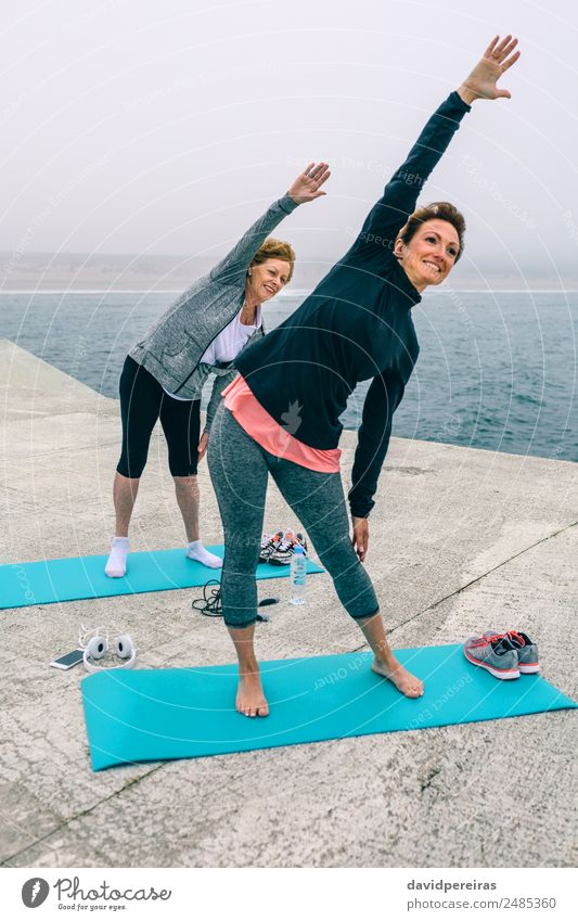 Senior woman with coach stretching side Bottle Lifestyle Happy Wellness Ocean Sports School PDA Human being Woman Adults Mother Grandmother Arm Hand Fog