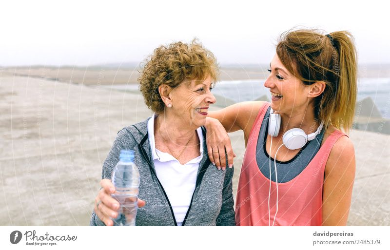 Senior sportswoman laughing with female friend Woman Human being Old Ocean Relaxation Adults Lifestyle To talk Sports Family & Relations Laughter Happy Together