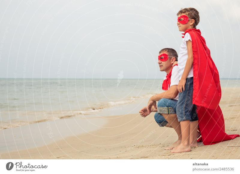 Father and son playing superhero on the beach Lifestyle Joy Happy Relaxation Playing Vacation & Travel Adventure Freedom Camping Summer Beach Child School