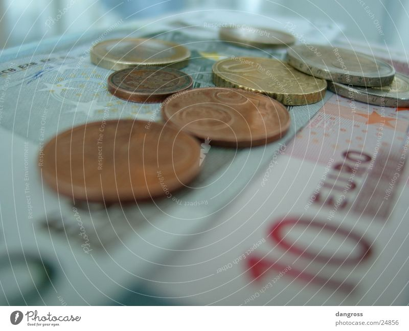 Coins on notes Money Blur Bank note Financial Industry
