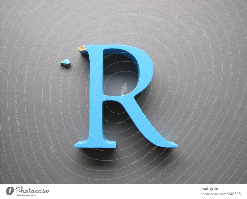 The facade is crumbling Characters Large Blue Gray Decline aborted Capital letter R Flaked off Colour photo Studio shot Close-up Deserted Copy Space left